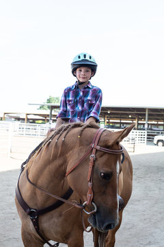 Girl on horse at a rodeo