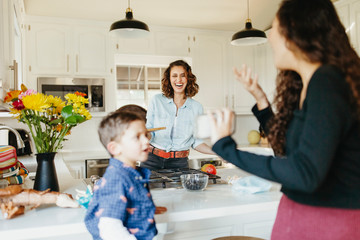 Happy family spending time in kitchen