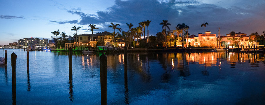 Lake Boca Raton and city skyline with reflections at sunset, panoramic view