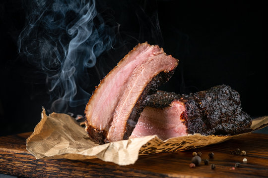 Sliced smoked beef brisket with dark crust from classic Texas BBQ smokehouse