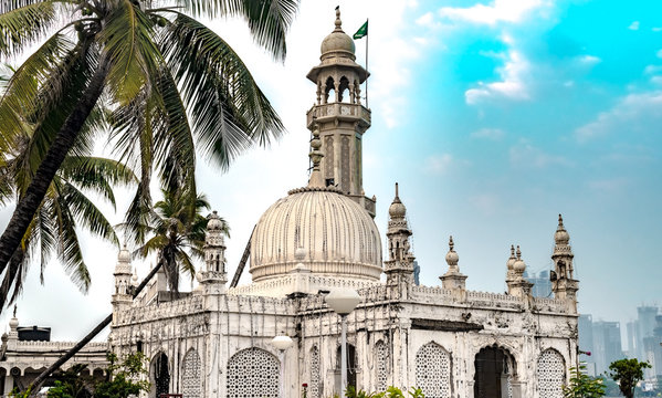 Famous Sufi Shrine of Pir Haji Ali Shah Bukhari known as Haji Ali Dargah. Made up of Marble in typical Indo-Islamic architecture, this shrine, a tourist spot is situated off the Worli Coast in Mumbai