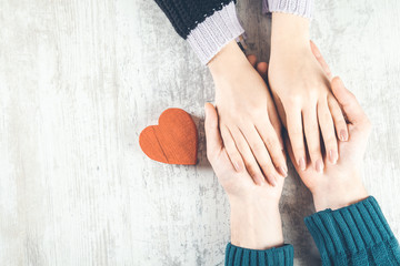 man and woman hand heart