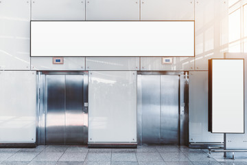 Two modern elevators in an airport terminal or a shopping mall or a railway station depot with two blank mockups: placeholder above and on the right, for your advertising or information text message Wall mural