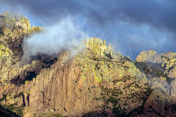 Colorful rock walls of Arizona's Chiricahua Mountains as a thunderstorm moves in