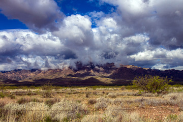 Storm clouds gather over Chiricahua Mountains near the town of Portal, Arizona