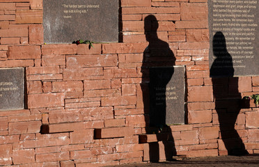 Visitors walk through the Columbine memorial a day before the school shooting's 20th anniversary in Littleton