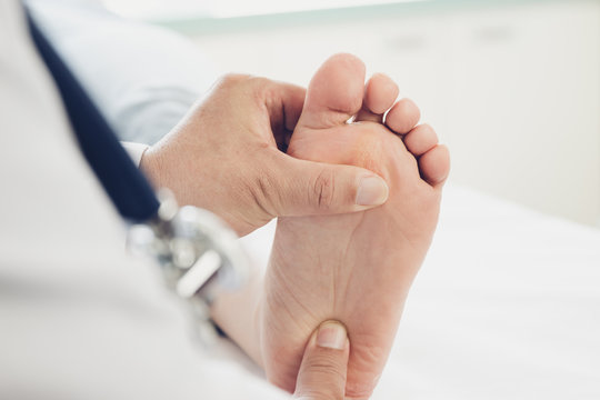Doctor giving a patient foot treatment