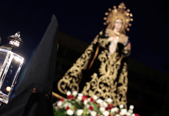 Devotees take part in a Good Friday procession of images in San Jose