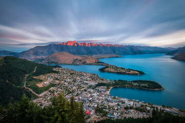 The Remarkables Mountain burning with a red light at sunset -View from Queenstown Skyline in New Zealand.