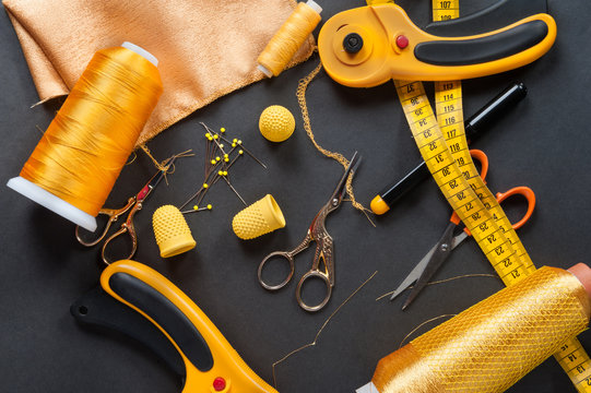 Yellow sewing measuring tape on dark