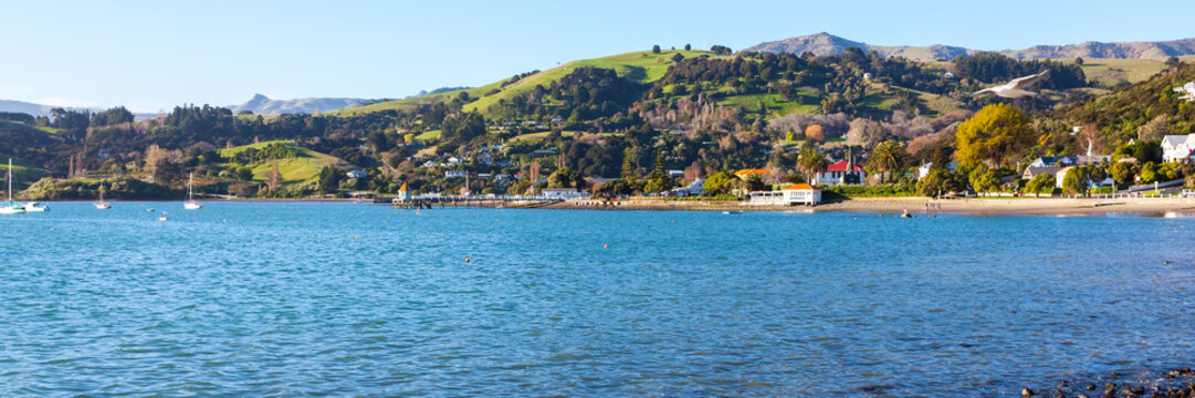 Panoramic photo of the harbourside in the French settlement town of Akaroa in the South Island of New Zealand.