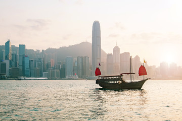 Poster White Hong Kong skyline with a traditional boat seen from Kowloon, Hong Kong, China.