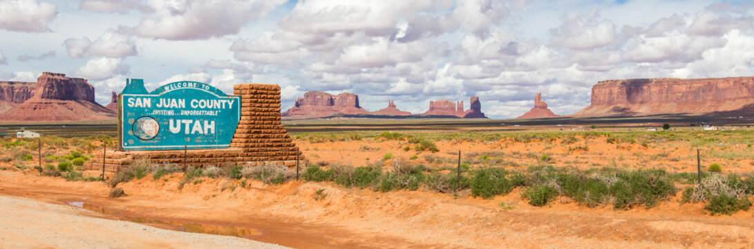 Welcome sign in desert for San Juan County in Monument Valley in Utah.