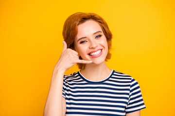Close up photo beautiful amazing she her lady hand telephone symbol call center staff adviser agent manager expert wear casual striped white t-shirt outfit clothes isolated yellow bright background Wall mural