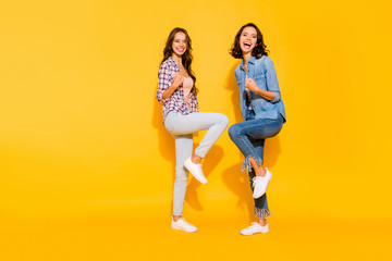 Full length body size view photo charming funny funky fellows fellowship feel glad content travel summer raise fists celebrate luck lucky wear checkered clothing isolated on colorful background