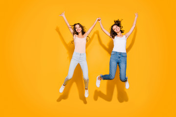 Wall Mural - Full length body size view photo lovely sweet teens people beautiful summer travel weekends holiday free time foolish hipsters satisfied glad long hair checked jeans shirts isolated yellow background