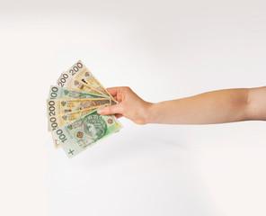 Fototapeta Dłoń trzymająca wachlarz pieniędzy