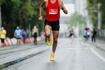 Fototapete - male runner running city marathon race at number 1