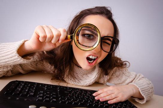Funny nerd girl working on computer