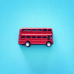 Photo on textile frame London red bus London traditional red double decker bus over blue background.