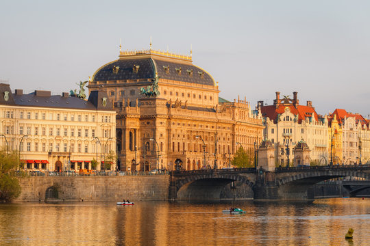 National Theater building in Prague, Czech Republic with Vltava River at sunset