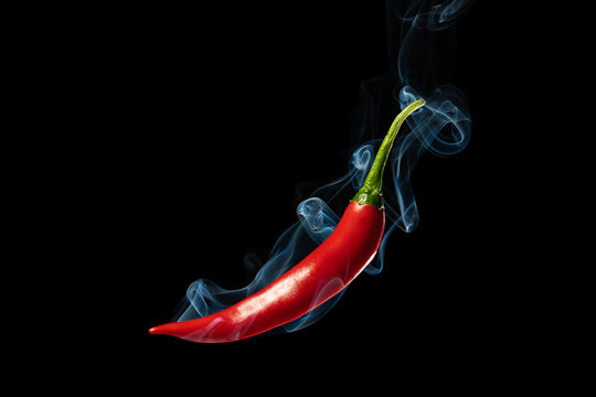 Smoking Chili on black background. Photo was made in Studio
