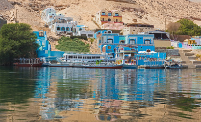 View of river nile in Aswan Egypt with traditional Nubian village on riverbank Fototapete