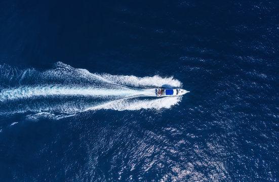 Yachts at the sea in Bali, Indonesia. Aerial view of luxury floating boat on transparent turquoise water at sunny day. Summer seascape from air. Top view from drone. Travel - image