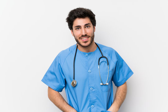Surgeon doctor man over isolated white wall laughing