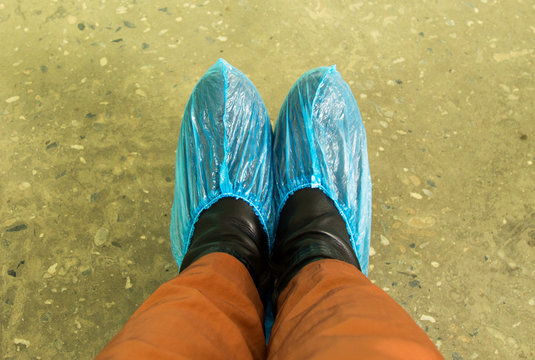feet blue Shoe covers in the hospital the patient. Cleanliness in the clinic
