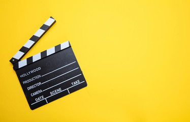 Movie clapperboard on yellow color background, top view Wall mural