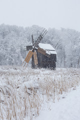 Windmill in Village Museum during snowy winter