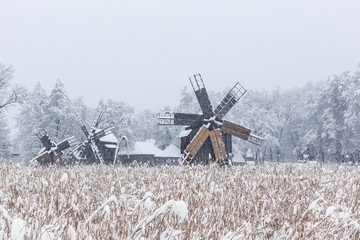 Windmills in Village Museum during snowy winter