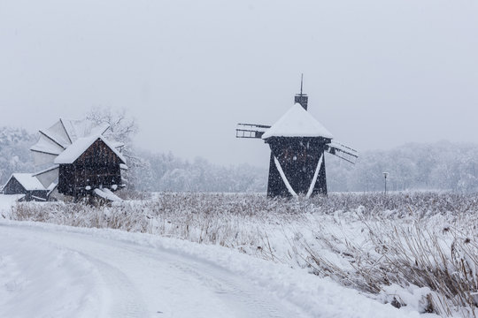 Windmills in Village Museum during snowy winter