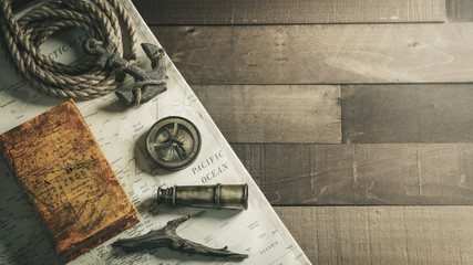 Vintage Nautical Travel Instruments With Rope Anchor And Map On Wooden Ship Deck Background - Travel / Leadership Concept