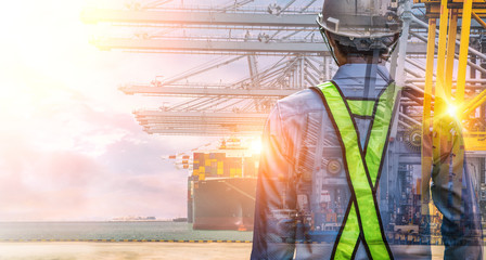 The double exposure image of the engineer standing back during sunrise overlay with Container Cargo ship and Cargo plane with working crane bridge in shipyard
