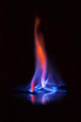 Flame of burning alcohol on black background. Gas flame. Black background. Abstract blaze fire flame texture background.