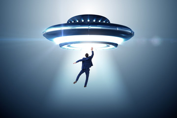 Printed roller blinds UFO Flying saucer abducting young businessman