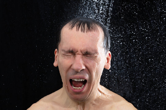 Man Screaming Under Cold Shower