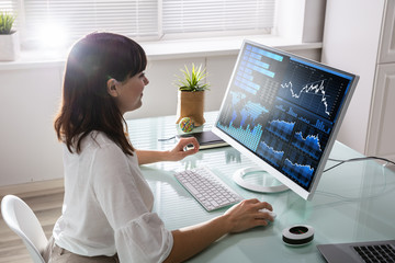 Stock Market Broker Analyzing Graph On Computer