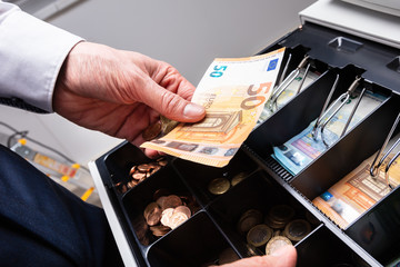 Euro Banknotes And Coins In Cash Box