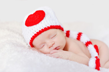 Newborn baby wearing a knitted hat