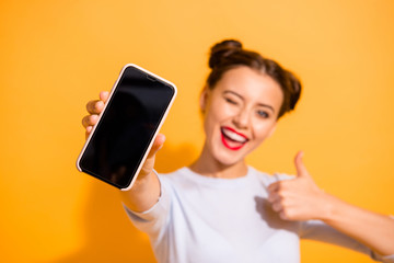 Fototapeta Close up photo of funky energetic student showing her mobile phone agreement appreciation wearing light cotton outfit on colorful background obraz