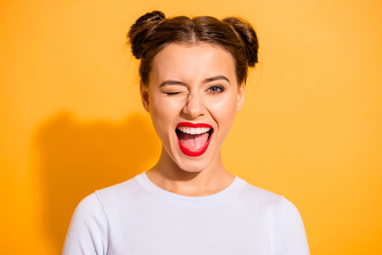 Close up portrait of lovely cute funny lady making winks opening her mouth shouting yeah having holidays dressed in white comfortable clothing isolated on bright background