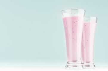 Autocollant pour porte Lait, Milk-shake Two fresh purple milkshakes of blueberry closeup on soft light mint color background and white wooden table, copy space.