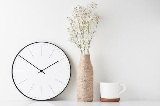 Home office minimal workspace desk with wall clock