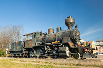 Kouvola, Finland - April 18, 2019: Old steam locomotive as an exhibit at the Kouvola railway station in Finland.