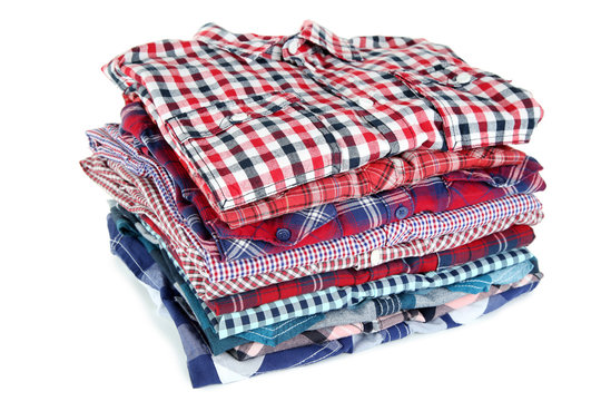 Stack of folded shirts isolated on white background