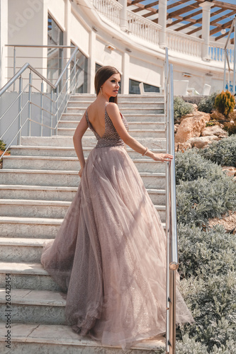 6dabe269f9c beautiful woman with long dark hair in luxurious evening dress ...