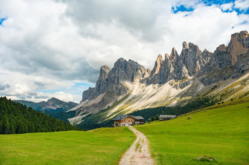 Beautiful mountain landscape of rifugio Brogles in Dolomites Italy. Tranquil hutte on top of mountain